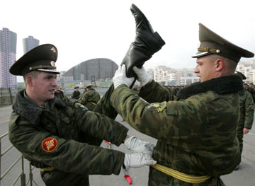 """Who put the stick up his ass?"" ""I did, remember? That's what we're doing here."" (Source: REUTERS/Alexander Natruskin (RUSSIA))"