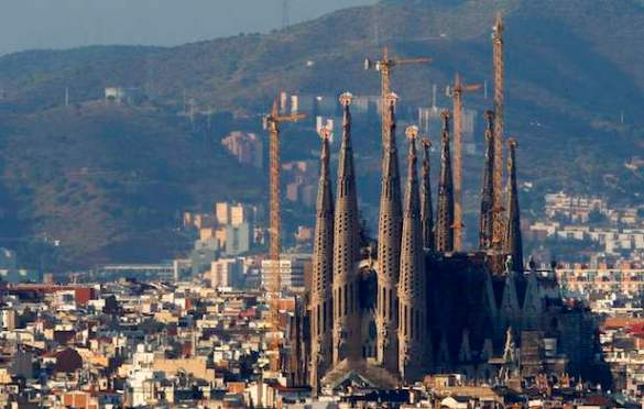 The Sagrada Familia temple is surrounded by construction cranes in Barcelona