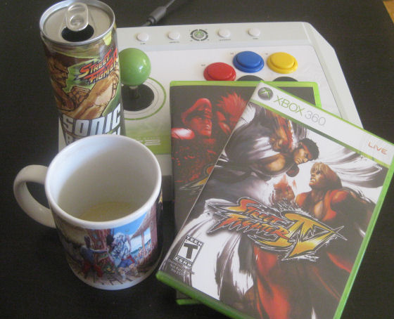 Yes, that is a custom-printed Street Fighter coffee mug. I wish I was drinking from that instead.